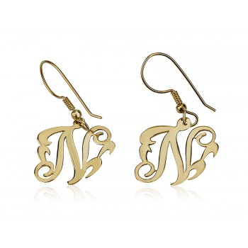 Earrings designed in a monogram style