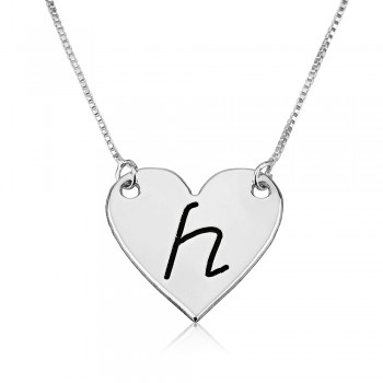 Gold heart shaped necklace with initial letters