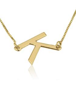 Gold necklace k vertical look